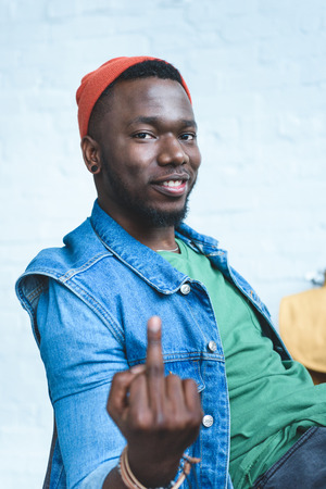 Young man showing middle finger