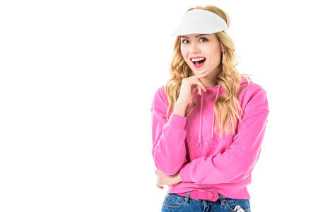 Blonde smiling girl in pink clothes isolated on white