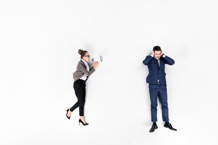top view of lady boss shouting at manager with loudspeaker isolated on white Archivio Fotografico - 111598402