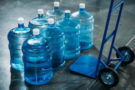 Delivery cart placed by water bottles Reklamní fotografie
