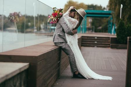 beautiful happy couple in bohemian style posing for wedding shoot Stock Photo