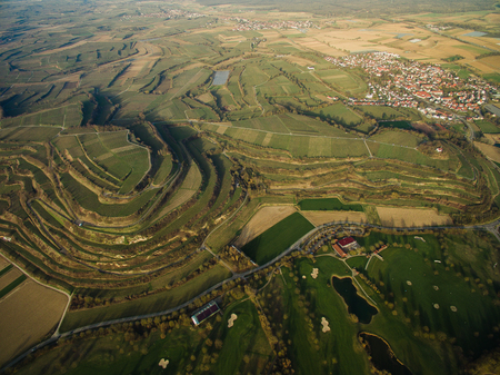 Aerial view of majestic landmark with green fields on tiers, Germany