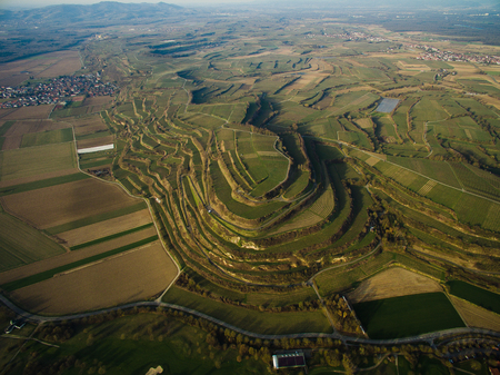 Aerial view of spectacular landscape with green fields on tiers, Germany
