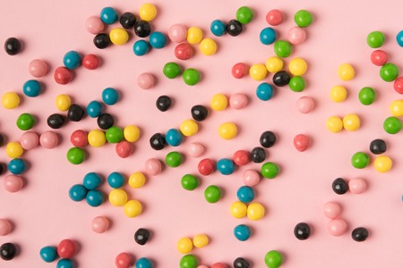 close up view of various candies isolated on pink Archivio Fotografico