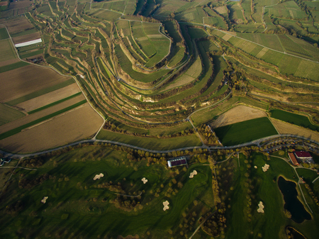 Aerial view of majestic landscape with green fields on tiers, Germany Stock Photo