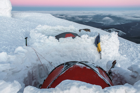 two tents in snow on mountain at early morning, Carpathian Mountains, Ukraine