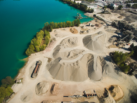 Aerial view of sand quarry or construction at river, Germany