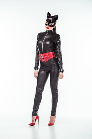 Kinky woman in sexy black costume and mask isolated on white Stock Photo