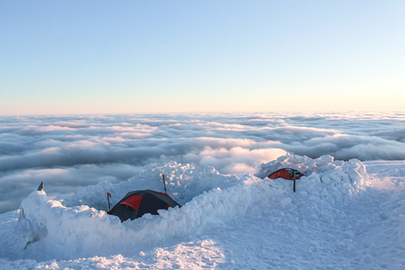 two tents on snowy mountain at sunrise, Carpathian Mountains, Ukraine Imagens