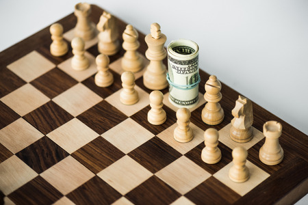 Chess board with cash and white chess pieces on white surface 스톡 콘텐츠 - 111603269