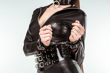 Kinky woman in sexy costume and handcuffs isolated on white 写真素材