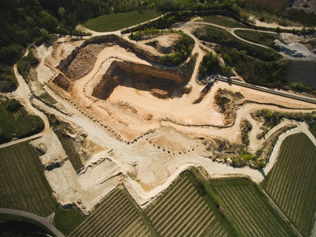 Aerial view of sand quarry with fields around, Germany