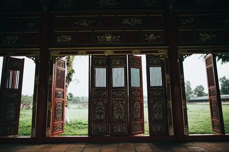 decorative doors in traditional oriental building, Hue, Vietnam