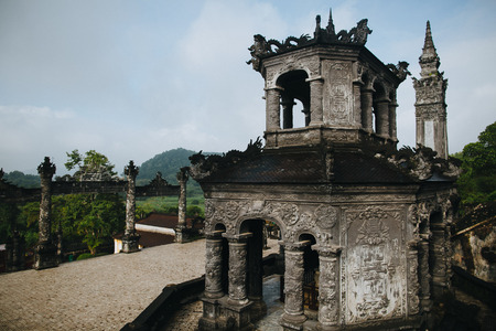 traditional ancient oriental architecture in green park, Hue, Vietnam Imagens