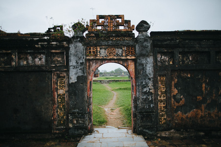 ruins of ancient gates with oriental symbols in Hue, Vietnam Stock fotó
