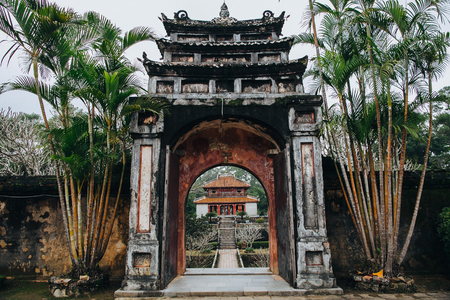 entrance to the beautiful oriental park with traditional ancient architecture in Hue, Vietnam