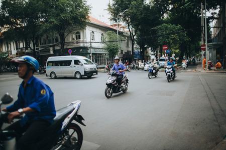 HO CHI MINH, VIETNAM - 03 JANUARY, 2018: policemen on motorbikes riding on busy street in Ho Chi Minh, Vietnam