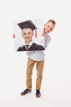 smiling boy pretending to be a graduate student, isolated on white