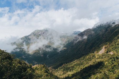 beautiful landscape with green vegetation on mountains and cloudy sky in Sa Pa, Vietnam Stockfoto