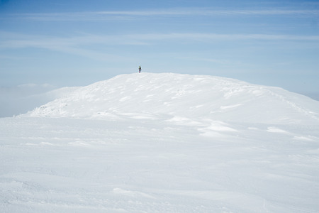 Alone climber standing on hill in Gorgany mountains