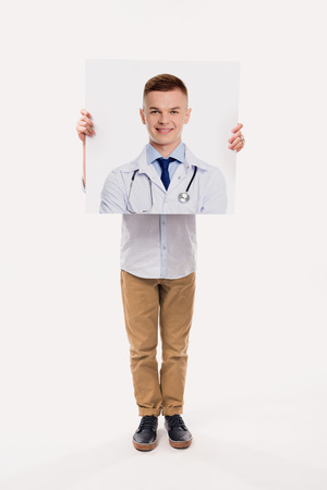 little boy pretending to be a doctor, isolated on white