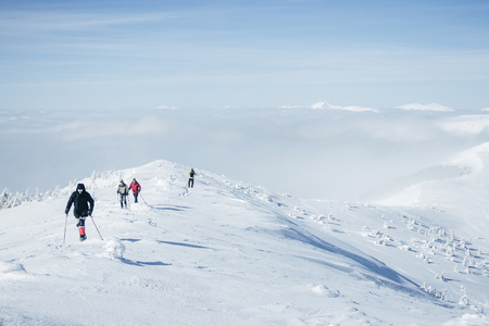 Travelers walking in Gorgany mountains in deep snow Standard-Bild - 111694847