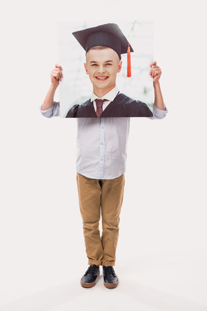 little boy pretending to be a graduate student, isolated on white