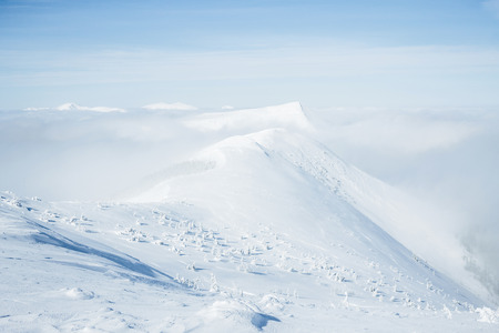 White hills covered with snow in Gorgany mountains 스톡 콘텐츠