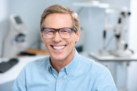 portrait of smiling middle aged man in eyeglasses