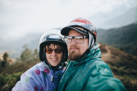 young couple of travelers looking at camera in Sa Pa, Vietnam