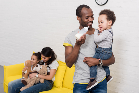 happy parents spending time with kids at home Archivio Fotografico