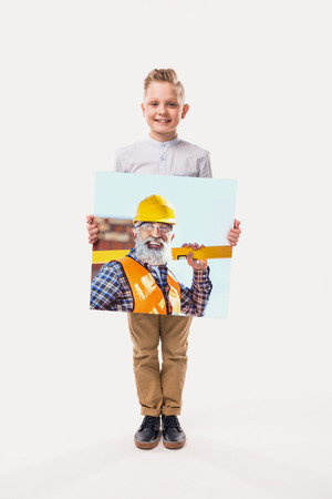 little smiling boy pretending to be workman, isolated on white Stock Photo