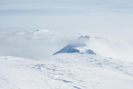 View of white Gorgany mountains and cloudy sky Фото со стока