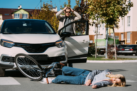 Young woman mowed down by driver in car on road, car accident concept Archivio Fotografico