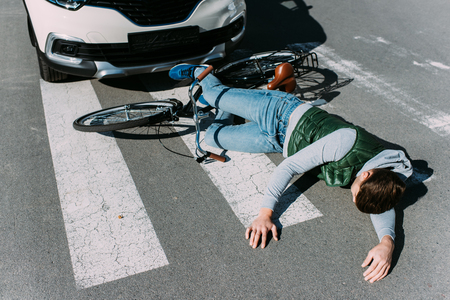 Male bicycle rider hit by car on road, car accident concept 写真素材 - 112271177