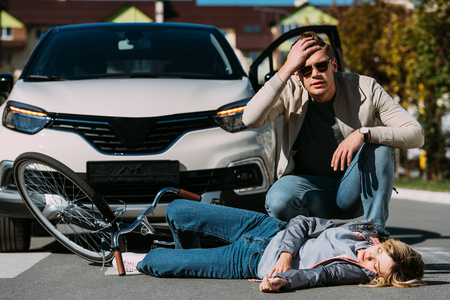 Young woman mowed down by driver in car on road, car accident concept Stock Photo