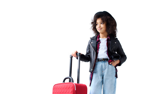 Adorable little child in stylish clothing with suitcase isolated on white Banque d'images