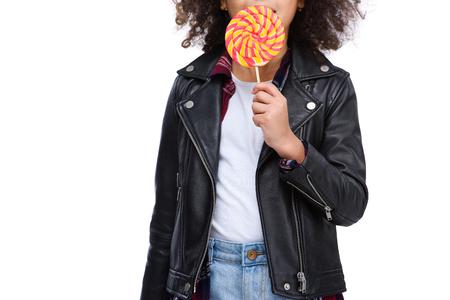 Cropped shot of little child eating lollipop isolated on white Reklamní fotografie