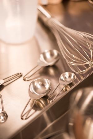 Close up view of kitchen utensils on metal counter in restaurant Reklamní fotografie