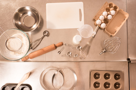 Top view of ingredients for dough and kitchen utensils on counter in restaurant Stock Photo