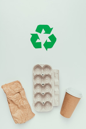 flat lay with recycle sign and disposable trash isolated on grey