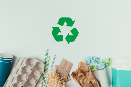 Flat lay with various types of garbage and recycle sign isolated on grey Standard-Bild - 112272411