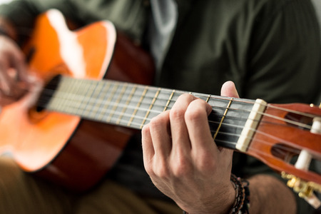 cropped image of man playing chord on acoustic guitar Reklamní fotografie