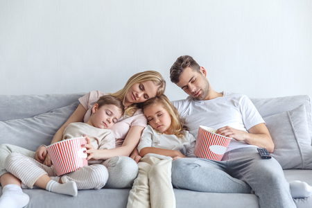 family fell a sleep while watch movie at home