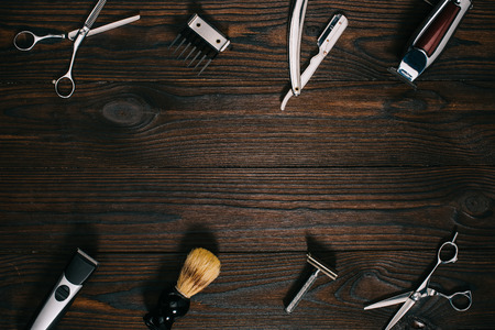 top view of arrangement of various barber tools on wooden tabletop Фото со стока - 111736902