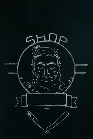 close up view of drawn emblem of bearded man on blackboard 스톡 콘텐츠