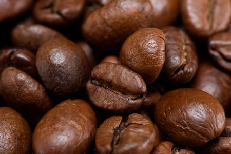 full frame of roasted coffee beans backdrop