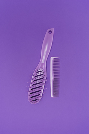 close up view of purple combs isolated on purple