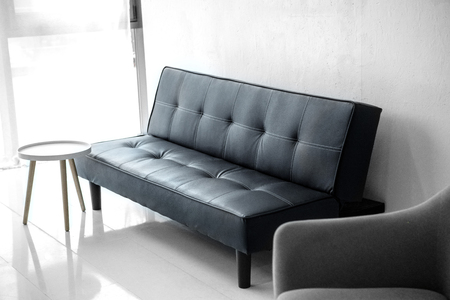 selective focus of modern living room with leather sofa and armchair Stock Photo