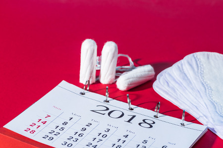 tampons, daily liners and calendar on red